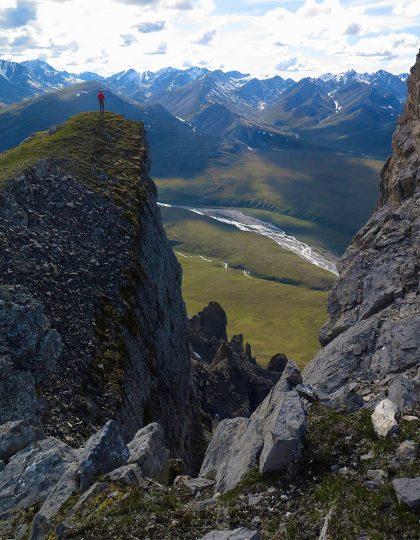 Hiker overlooks the Arctic National Wildlife Refuge in the Brooks Range of Alaska